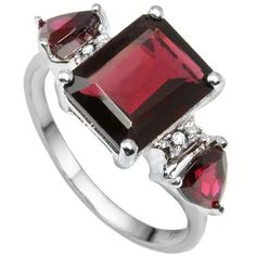 Garnet symbolizes true and never ending love and affection. Bright genuine white diamonds and fabulous garnets are on display in this lovely ring. This exclusive ring feature tripe simple & stunning red garnet stone, double dazzling white diamonds give a dash of sparkling brilliance to this ring. Carefully crafted in stunning 0.925 sterling silver plated with platinum, this romantic garnet diamond ring is sure to become an instant love. Today's price: $7.00