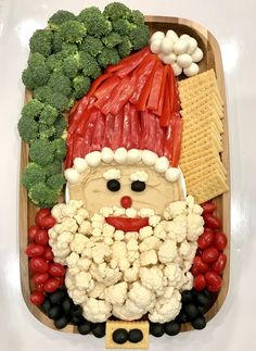 This simple and oh-so-cute Santa Snack Board, made out of hummus, veggies, cheese and crackers, is sure to put you at the top of the nice list! Fruit Christmas Tree, Christmas Treats, Christmas Eve, Xmas, Christmas Stuff, White Christmas, Holiday Snacks, Holiday Recipes, Club Crackers