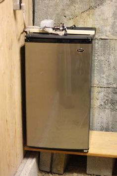 Directions for making a cheese cave out of an old fridge! Because every one should be aging Cheddar in their basement!