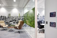 Office Wall Graphics of London Skyline with Green highlights and nature inspired window Graphics