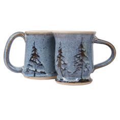 These beautiful mugs have a backdrop of pine trees silhouetted against the night sky. Each individually handcrafted pottery piece will remind you of the Northwood nights. No two pieces are exactly alike. All are lead free and dishwasher, oven and microwa Glazes For Pottery, Pottery Mugs, Ceramic Pottery, Pottery Designs, Mug Designs, Pottery Ideas, Ceramic Coffee Cups, Coffee Mugs, Pine Tree Silhouette