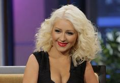"""Christina Aguilera: """"She tells me that she has always been 'intense and introverted' and that, as a result, she's felt like an outsider her entire life,"""" wrote one reporter of the 33-year-old singer. And yet Aguilera hasn't let that hold her back from crafting an image as a total exhibitionist, and winning not one but four Grammys in the process."""
