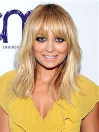 Inspiration for my latest haircut.  Love her long bangs.
