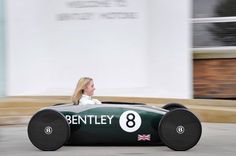 Greener Luxury Cars - The diminutive, soap-box Bentley Continental DC is a battery-powered electric car. The vehicle, with a carbon fiber body, was built by 10 young app. Bentley Continental, Soap Box Cars, Homemade Go Kart, E Motor, E Mobility, Bentley Motors, Pt Cruiser, Pedal Cars, Tricycle