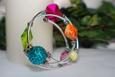 Multi-Colored Memory Wire Bracelet with Sun Charm on Etsy, $25.00