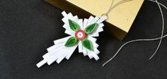 Do+you+love+quilling+paper+ornaments?+This+Pandahall+tutorial+will+show+you+how+to+make+cross+Christmas+quilling+paper+hanging+ornaments.