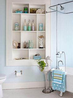 I love the beach and this bathroom wall and building in shelves reminds me of salt water and warm breezes!
