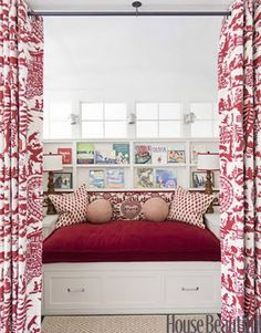 Curtains in front of the whole window seat = reading/play nook