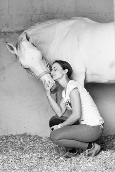This black and white photo really makes it all about the connection between human and horse, shooting it in color might distract from that