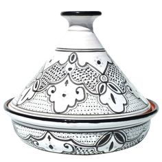 Cookable Tagine Black And White - Made of clay, a material known to enhance food's flavor and preserve its nutritional qualities throughout the cooking process, the exquisite earthenware dish was painted by hand at Le Souk Ceramique's small studio without the use of machinery, decals, or stencils. This pot is ideal for cooking on the stove over low heat, and can be used to prepare a range of dishes, from traditional Moroccan stews to pumpkin pie.