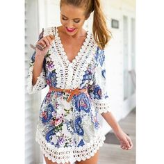 Floral and lace trip playsuit Like new! Floral quarter sleeve dress with lace trim. Dresses Mini