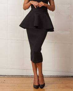 """- High waisted - Exaggerated peplum at waist - Midi-length - Exposed back zipper for closure - Main: 95% Polyester, 5% Elastane - Our Model wears an XS and is 5'8"""" - Measurements: Bust:32"""",Waist 25"""",H"""