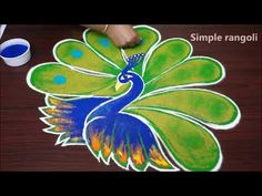 simple peacock rangoli designs for diwali easy kolam designs with out dots Rangoli Designs Flower, Rangoli Border Designs, Colorful Rangoli Designs, Beautiful Rangoli Designs, Kolam Designs, Clay Ganesha, Peacock Rangoli, Holi Special, Rangoli Borders
