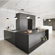 We thought our @flosscandinavia cone string pendants dangling from the studio ceiling were über cool. However, this black kitchen design + these sphere string pendants just takes our breath away. #blackkitchen #scandinaviandesign #scandinavianinteriors #minimalistkitchen #minimalistdesign #minimalistinteriors #minimalist #monochromehome