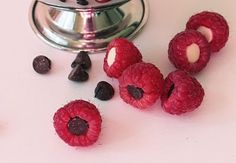Raspberries filled with chocolate chips! Beautiful and tasty.