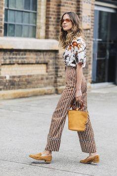 Mixed prints: floral top, polka dot pajama pants, bucket bag, and loafers