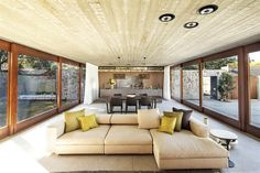 Wooden plank imprinted concrete ceiling.. Love this ceiling.. And big sliding glass doors to create open space..