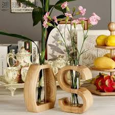 Resultado de imagen para floreros madera                              …