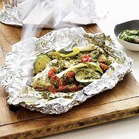 Pesto Chicken Grill Packets -  Boneless Chicken Breasts, Pesto, Zucchini, Tomatoes, Scallions all wrapped up in foil and Grilled for 25 minutes.  Maybe you can make these in the oven too?
