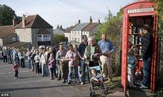 Book box: Villagers in the Somerset village of Westbury-sub-Mendip wait in line to use the country's smallest library which was converted from an old red phone box Little Free Libraries, Free Library, Somerset Village, Image Internet, Mobile Library, Lending Library, Telephone Booth, Old Phone, Small World