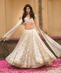 Classic. Gold and white. Love the lehenga, the blouse needs some work.