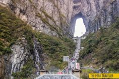 Tianmen Shan (Heaven's Gate Mountain) is a cave natural arch eroded through a karst syncline. It is located about 8 km south of the city of Zhangjiajie (formerly Dayong) in northern Hunan Province, China. It is accessed from Zhangjiajie by what may be the world's longest skytram (7.5 km) that leads to a bus ride on a very winding road, followed by a set of stairs with 999 steps.
