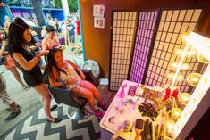 """Many music festivals this year offered amenities to attendees that included beauty booths and necessary goods. Bud Light's traveling House of Whatever activation at Lollapalooza, which took place in Chicago's Grant Park from July 31 to August 2, had a """"Tattoos and 'Dos"""" booth, which offered braiding, hair chalking, and other festival-inspired hairstyling services.  Photo: Barry Brecheisen for Bizbash"""