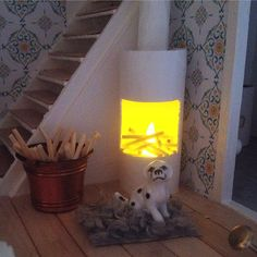 Fireplace made with a toilet paper roll and a LED tea light!#dockhus #dockskåp…
