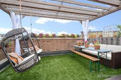 Astroturf and swinging seats will transform your patio into the coolest space on the block.