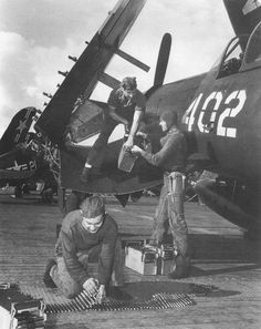 Crewmen of the USS Boxer prepare an F4U Corsair for a combat mission over Korea, c. 1950. #aircrafts