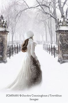 Trevillion Images - woman-in-white-gown-and-fur-walking-in-the-snow
