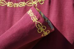 Medieval Gown in Burgundy with Gold Embroidery (close up on the embroidery)