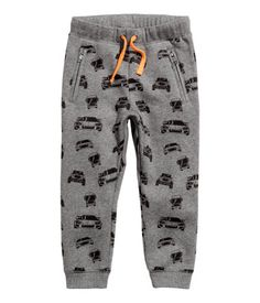 Sweatpants with an elasticized drawstring waistband, side pockets with zip, and ribbed hems.