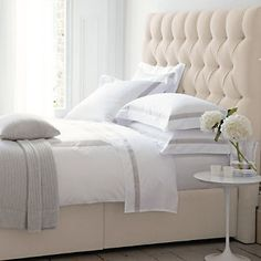 all white bedroom ideas. White upholstered bed with tall headboard. Tulip base side table is perfect in a guest bedroom. The White Company, White Headboard, Double Headboard, Linen Headboard, White Upholstered Bed, White Sheets, White Bed Linens, Headboards For Beds, Trendy Bedroom