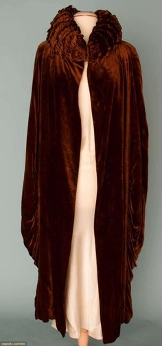 Aubergine Silk Velvet Opera Coat, Rolled And Ruched High Collar, Coccoon Shape With Draped Side Panels, White And Gold Lame Lining In Deco Floral Print   c.1912-1918