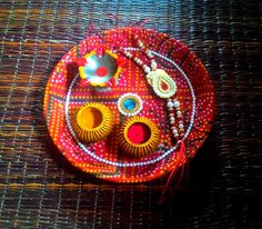 This Rakhi get little trendy in desi style. Use traditional eye catching thali designs form us.