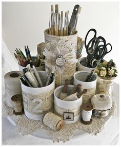 great use of old cans and a very pretty organizer for a ladies craft table.