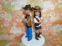 This listing is for a bride and groom wedding cake topper, which starts at $130 and made to fit your description (attire, hair and eye color, bouquet