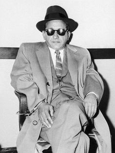 Sam Giancana inherited the Chicago Outfit, the mafia syndicate built by Capone and Nitti. Closely associated with Judith Campbell who became JFK's mistress. www.lberger.ca