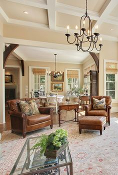 The black chandelier and brown leather chairs in this living room add a classic & comfortable vibe. Photo by VHT http://tour.vht.com/433221245/1436-peachtree-battle-atlanta-ga-30327/photos