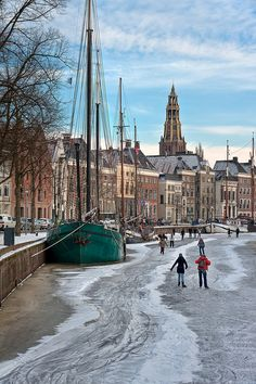 Frozen Canal, Groningen, the Netherlands. Looking at a map of the Netherlands, Groningen seems a long way from anywhere – looks can be deceiving...  Read more: http://www.lonelyplanet.com/the-netherlands/the-north-and-east/groningen-city#ixzz3Lhd5603y