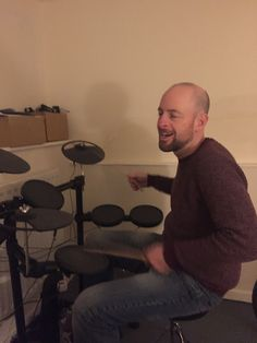Ages ago me and my dads girlfriend bought him an electronic drum kit for his birthday. This is him looking well chuffed