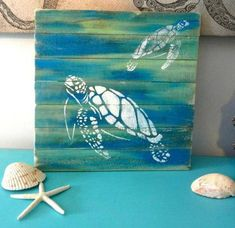 Whether it's in the dining room or on the pool deck, spice up your decor with beautiful re purposed pallet art. Each art piece is an original! While the size and design of the piece you order will be similar to what you see in the photograph, the item you Arte Pallet, Wood Pallet Art, Reclaimed Wood Art, Repurposed Wood, Diy Wood, Frosch Illustration, Sea Turtle Art, Sea Turtle Painting, Turtle Crafts