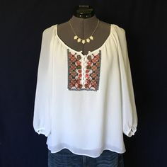 """Sanctuary Embroidered Peasant Blouse Beautiful!!  All embroidery is perfectly intact. 3/4 length sleeves. Made of 100% viscose, it has textured look and feel to it. The front of blouse has two layers of the fabric so it's not see thru...but the sleeves and back are just one layer so it is. I have a nude camisole under it on my dress form model. Wide neckline, button up front. Size Small, it's a typical oversized flowy peasant blouse fit. Bust measured flat is 17.5"""", back of neck to hem is…"""