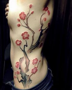 Plum blossoms done by Louisa. #workproud #wearproud Tattoo shared by chronicink