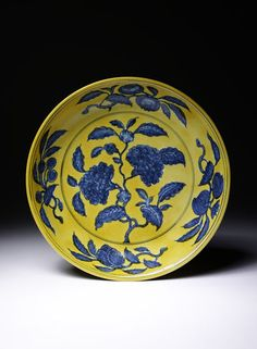 Dish      Place of origin:      Jingdezhen, China (made)     Date:      1506-1521 (made)     Artist/Maker:      unknown (production)     Materials and Techniques:      Porcelain decorated in underglaze blue and yellow glaze