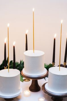 simple white cakes with gold candles