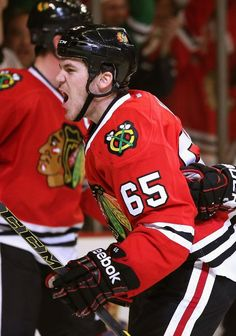 CHICAGO, IL - APRIL 23: Andrew Shaw #65 of the Chicago Blackhawks celebrates a second period goal against the St. Louis Blues in Game Four of the First Round of the 2014 NHL Stanley Cup Playoffs at the United Center on April 23, 2014 in Chicago, Illinois. (Photo by Jonathan Daniel/Getty Images)