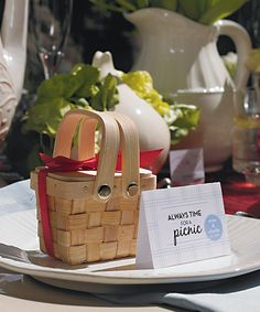 Life is a picnic!  You can probably find and buy mini picnic baskets at The Dollar Tree or Michaels.