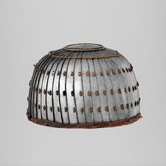Lamellar Helmet Date: 13th–15th century Culture: Mongolian or Tibetan Medium: Iron, leather Dimensions: H. 5 1/2 in. (14 cm); Diam. 9 in. (22.9 cm) Classification: Helmets Credit Line: Purchase, Gift of William H. Riggs, by exchange, and The Sulzberger Foundation Inc. Gift, 1999